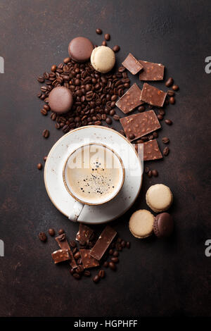 Coffee cup, beans, chocolate and macaroons on old kitchen table. Top view - Stock Photo
