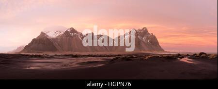 Vestrahorn mountain at the black volvanic beach near Stokksnes at sunset in winter, hofn, Iceland. - Stock Photo
