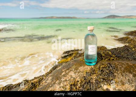 Bottle of Isle of Harris gin on hebridean beach of Traigh Iar, Isle of Harris, Outer Hebrides, scotland. - Stock Photo