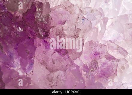 Raw, uncut rose quartz crystal close up macro - Stock Photo