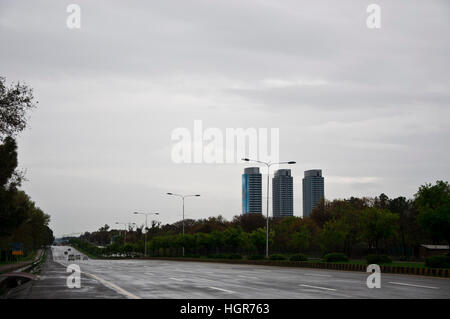 Jinnah Ave. in the capital city with Centaurus mall in the background on a cloudy day. - Stock Photo