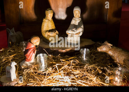 Mary and Joseph and baby Jesus Christ at the centre of a Nativity scene in a French Church in France at Christmas - Stock Photo