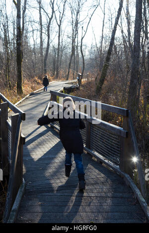 Child girl tourist tourists & hikers walkway / pathway / foot path / footpath. Marais de Lavours National Nature - Stock Photo