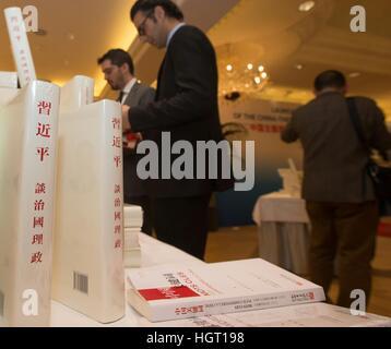 Geneva, Switzerland. 9th Jan, 2017. Guests read Chinese President Xi Jinping's book 'Xi Jinping: the Governance - Stock Photo