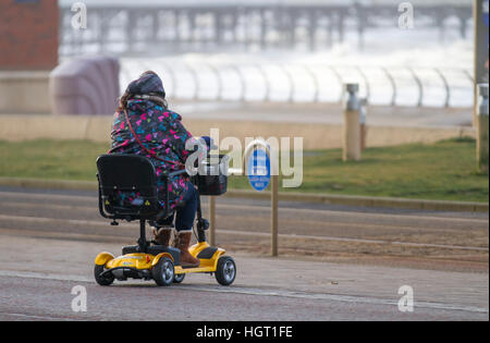 Blackpool, Lancashire, UK. 13th Jan 2017. UK Weather. Senior, Wheelchair user, a pensioner disabled person using - Stock Photo