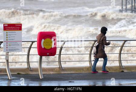 Blackpool, Lancashire, UK. 13th Jan 2017. UK Weather. Hardy souls brave the stormy waves on the Blackpool's famous - Stock Photo