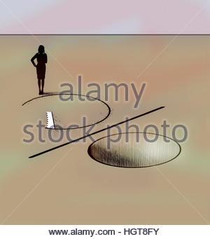 Businesswoman watching saw cutting percentage sign hole in ground - Stock Photo