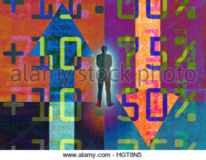 Businessman analyzing contrasting financial figures - Stock Photo