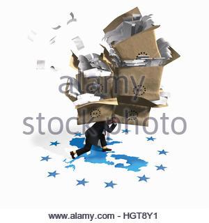 Businessman struggling under the weight of European Union bureaucracy - Stock Photo