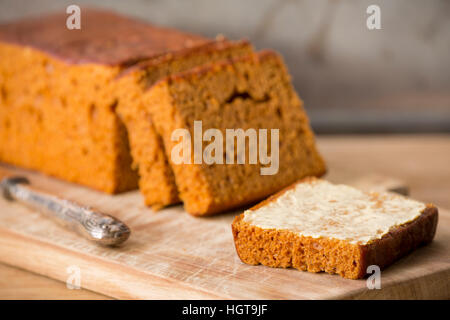 Slices of 'ontbijtkoek', traditional Dutch spice bread, with butter. - Stock Photo