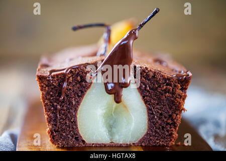 Chocolate sponge cake with poached pear - Stock Photo
