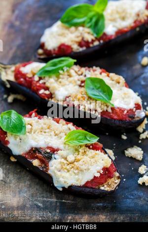 Roast aubergines with tomatoes and  mozzarella - Stock Photo