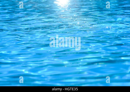 Swimming pool water, natural abstract background with sunlights - Stock Photo