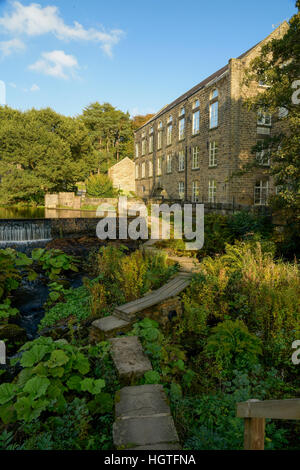 Former cotton mill on the river Derwent converted to  flats Derbyshire England - Stock Photo