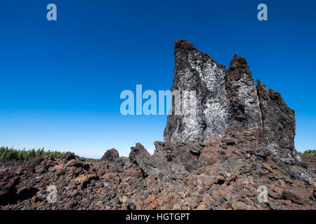 Crossing over the solidified lava flow from Chinyero volcano on Teide, Tenerife, Canary Islands, Spain - Stock Photo