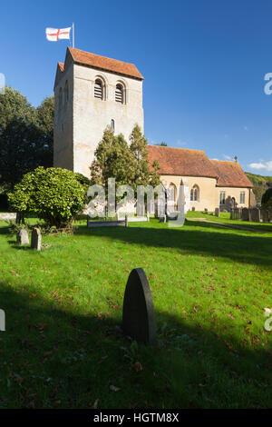 The church of St Bartholomew with the flag of St George flying from its saddleback tower, Fingest, Buckinghamshire, - Stock Photo