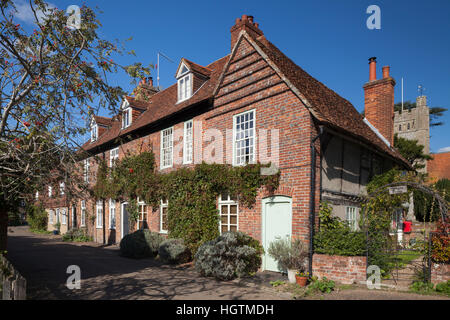 A row of cottages and the church of St Mary the Virgin in the Chiltern Hills village of Hambleden, Hambleden Valley, - Stock Photo