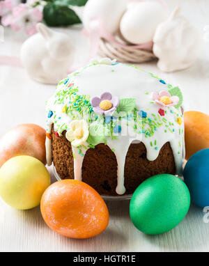Easter cake with glace icing and easter eggs on white for Glace decoration