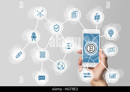 Blockchain and bitcoin concept visualized by mobile phone and grey background - Stock Photo