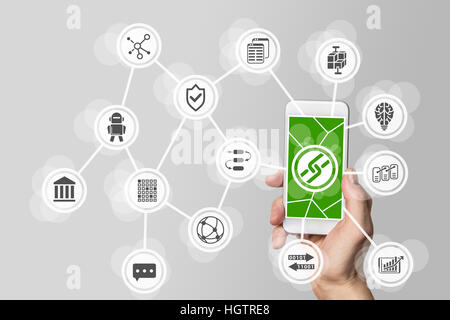 Blockchain and bitcoin concept with hand holding mobile phone - Stock Photo
