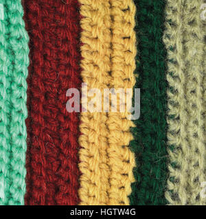 Knitted fine wool garment colorful stripes background natural texture, yellow, beige, claret, blue, green scarf - Stock Photo