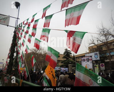Iranian flags at Islamic Revolution anniversary rally, national day of Iran in Tehran - Stock Photo