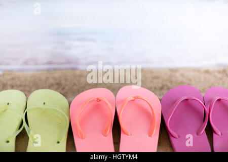 Background of summer vacation with flip-flaps on boards, flowers ...