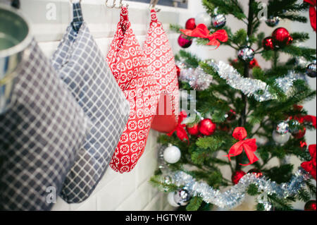 decoration festive home interior. Christmas sock and Christmas tree - Stock Photo