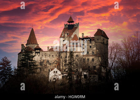 Bran Castle, Transylvania, Romania. Stunning sunset over the castle of Dracula. - Stock Photo