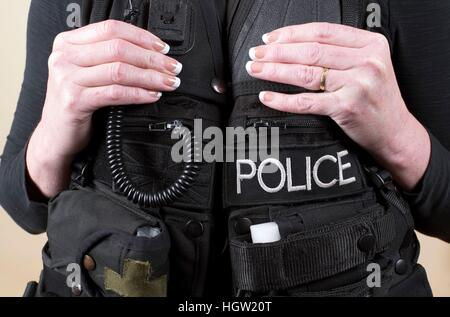 Married police officer wearing a tactical vest - Stock Photo