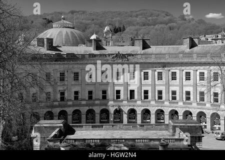 The Crescent buildings and the Slopes Gardens, in the market town of Buxton, Peak District National Park, Derbyshire, - Stock Photo