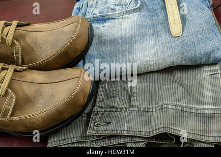 Rugged men fashion with  Jeans watch jacket and Brown suede leather shoes on wooden background. - Stock Photo