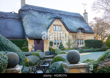 Traditional Cotswolds thatched roof stone property in the market town of Chipping Campden,Gloucestershire,England - Stock Photo