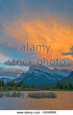 A sunset lights clouds over Mount Rundle and Vermillion Lakes. - Stock Photo