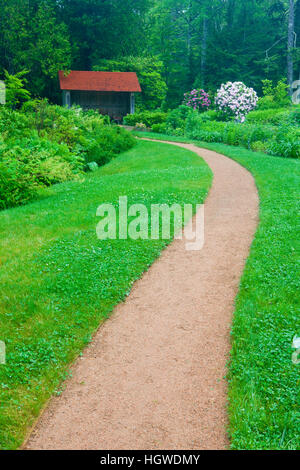 A path at Thuya Gardens in Northeast Harbor, Maine. - Stock Photo