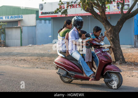 Man with his wife and two children riding on a motor scooter - Stock Photo
