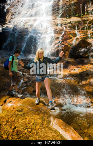 A couple hiking at Arethusa Falls in Crawford Notch State Park in New Hampshire's White Mountains. - Stock Photo
