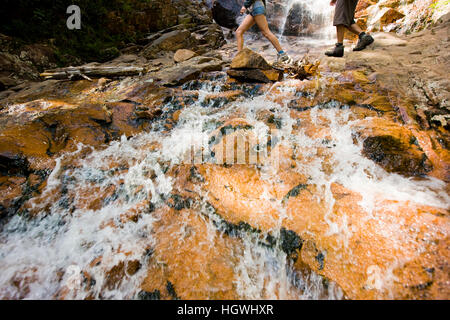 Hikers at Arethusa Falls in Crawford Notch State Park in New Hampshire's White Mountains. - Stock Photo