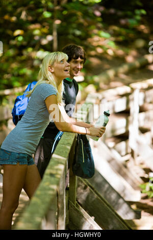 A couple hiking near Arethusa Falls in Crawford Notch State Park in New Hampshire's White Mountains. - Stock Photo