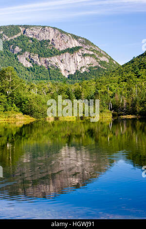 The cliffs of Mount Willey as seen from Willey Pond in New Hampshire's Crawford Notch State Park.  White Mountains. - Stock Photo
