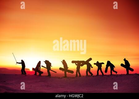 Group team snowboarder ski concept sunset - Stock Photo