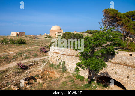 View of the Fortezza citadel, Rethymno, Crete, Greece, with Mosque of Sultan Ibrahim in background - Stock Photo
