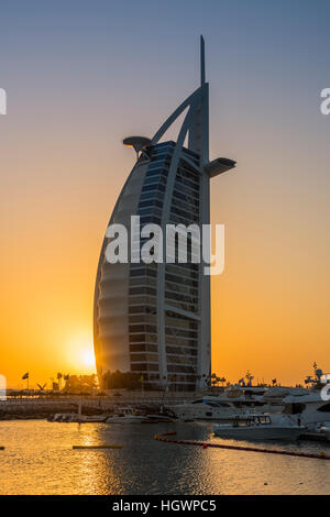 Burj Al Arab luxury hotel at sunset, Dubai, United Arab Emirates - Stock Photo