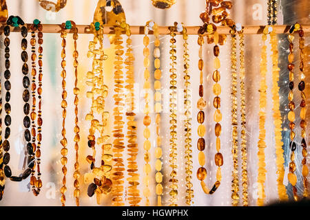 Variety Of Beads Made Of Amber. Jewellery Made Of Amber. Traditional Souvenirs At European Market. Souvenir From - Stock Photo