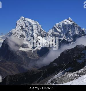 High mountains in the Everest National Park, Nepal. Mount Cholatse and Taboche Peak, view from Renjo La mountain - Stock Photo