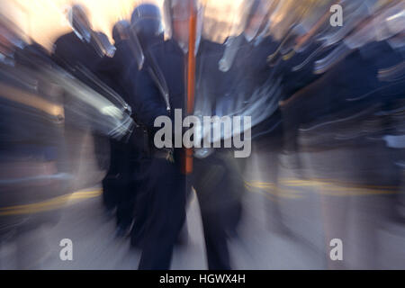 Police officers in riot gear Stock Photo