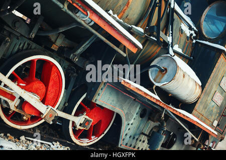Details of an old retro steam locomotive during winter. - Stock Photo