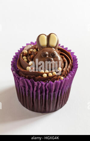 Easter cupcake with milk chocolate bunny rabbit on isolated on white background - Stock Photo