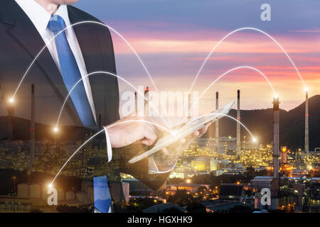 Double exposure of engineer using digital tablet pc assistance control machine to manufacturing in factory. Smart - Stock Photo