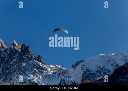 A parapenter flying in the Chamonix valley - Stock Photo